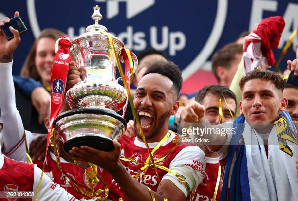 Arsenal captain Pierre-Emerick Aubameyang of Arsenal lifts the FA Cup Trophy following the FA Cup Final match between Arsenal and Chelsea at Wembley...