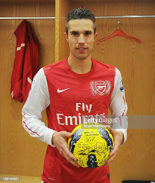 Arsenal captain Robin van Persie with the signed matchball after his hat-trick in the Barclays Premier League match between Arsenal and Blackburn...