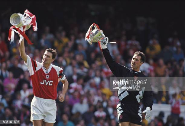 Arsenal captain Tony Adams and goalkeeper David Seaman show off the previous seasons trophys before the FA Premiership match against Everton at...