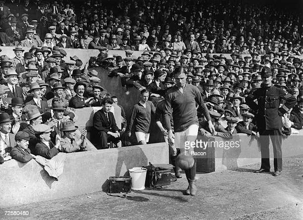 Arsenal captian Charlie Buchan leading his team out at Highbury stadium for the opening game of the 1925 season against Tottenham 29th August 1925