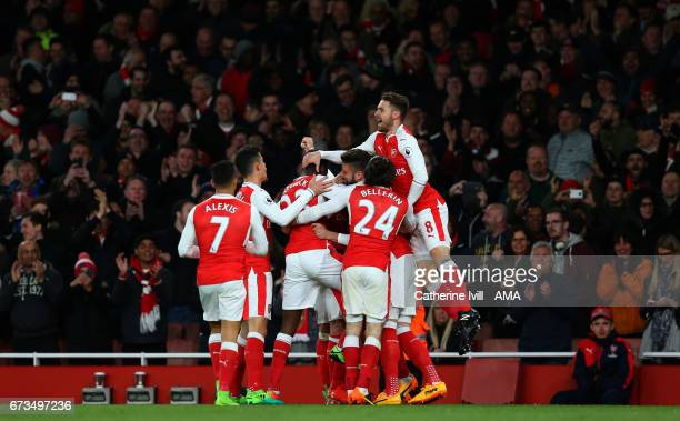 Arsenal celebrate after Nacho Monreal of Arsenal scores to make it 10 during the Premier League match between Arsenal and Leicester City at Emirates...