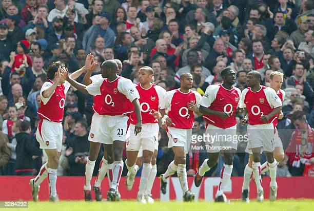 Arsenal celebrate after Thierry Henry of Arsenal scored the first goal for Arsenal during the FA Barclaycard Premiership match between Arsenal and...