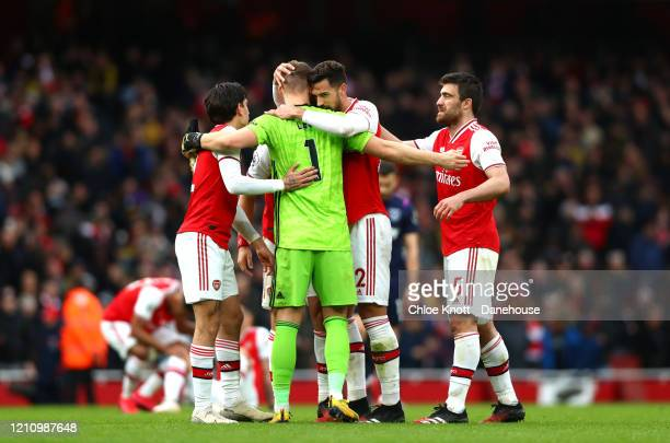 Arsenal celebrate after winning the Premier League match between Arsenal FC and West Ham United at Emirates Stadium on March 07 2020 in London United...