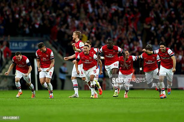 Arsenal celebrate as the win 42 in the penalty shoot out during the FA Cup SemiFinal match between Wigan Athletic and Arsenal at Wembley Stadium on...