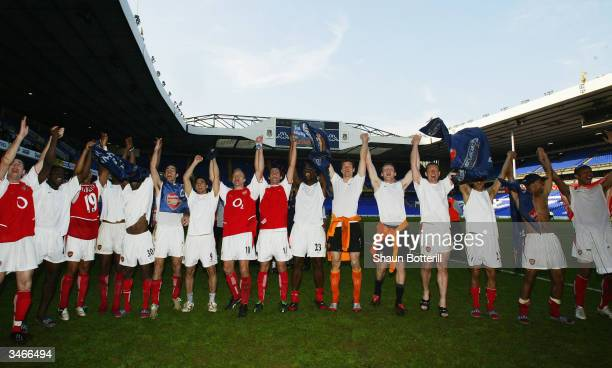 Arsenal celebrate at the end of the FA Barclaycard Premiership match between Tottenham Hotspur and Arsenal at White Hart Lane on April 25 2004 in...