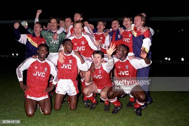 Arsenal celebrate winning the League Championship after their 31 win coach Stewart Houston Nigel Winterburn David Seaman Tony Adams Steve Bould David...