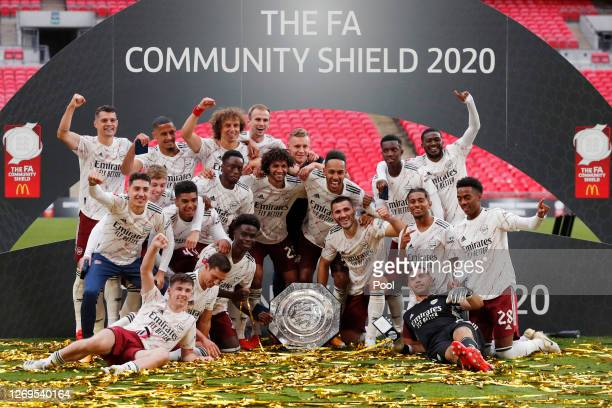 Arsenal celebrate with the Community Shield Trophy following his team's victory in during the FA Community Shield final between Arsenal and Liverpool...