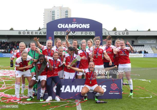 Arsenal celebrate with the trophy after the WSL match between Arsenal Women and Manchester City at Meadow Park on May 11 2019 in Borehamwood England