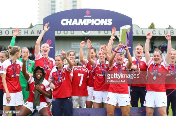Arsenal celebrate with the trophy after winning the Women's Super League after the WSL match between Arsenal Women and Manchester City at Meadow Park...