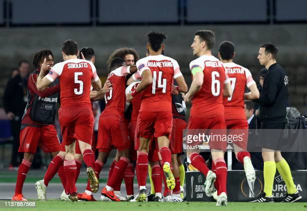 Arsenal celebrates after the goal scored by Alexandre Lacazette during the UEFA Champions League quarterfinals second leg football match SSC Napoli v...