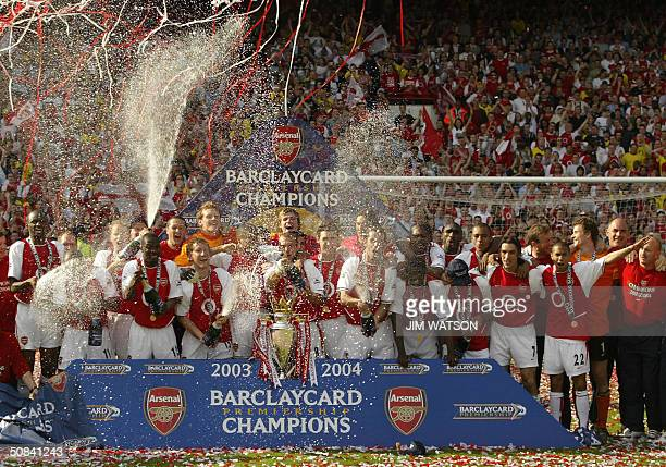 Arsenal celebrates winning the Premiership title and defeating Leicsester City 15 May 2004 at Highbury in London Arsenal defeated Leicester City 21...