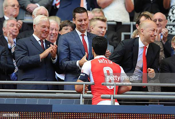 Arsenal Chairman Sir Chips Keswick and director Josh Kroenke with captain Mikel Arteta after the FA Community Shield match between Chelsea and...