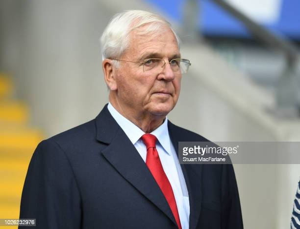 Arsenal Chairman Sir Chips Keswick in the directors box before the Premier League match between Cardiff City and Arsenal at Cardiff City Stadium on...