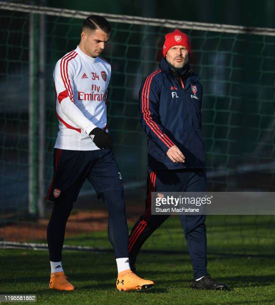 Arsenal coach Freddie Ljungberg and Granit Xhaka before a training session at London Colney on December 23 2019 in St Albans England
