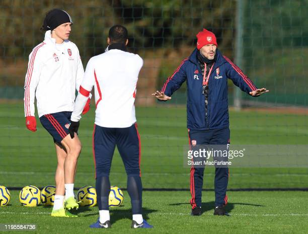 Arsenal coach Freddie Ljungberg with David Luiz and Alex Lacazette during a training session at London Colney on December 23 2019 in St Albans England