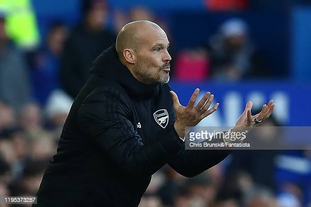Arsenal coach Fredrik Ljungberg gestures from the touchline during the Premier League match between Everton FC and Arsenal FC at Goodison Park on...