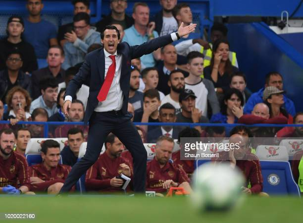 Arsenal coach Unai Emery shouts instructions during the Premier League match between Chelsea FC and Arsenal FC at Stamford Bridge on August 18 2018...