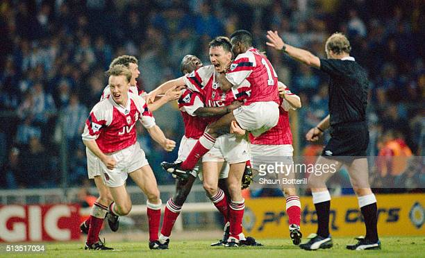 Arsenal defender Andy Linighan is mobbed by team mates after scoring the winning goal in extra time to win the 1993 FA Cup Final replay between...