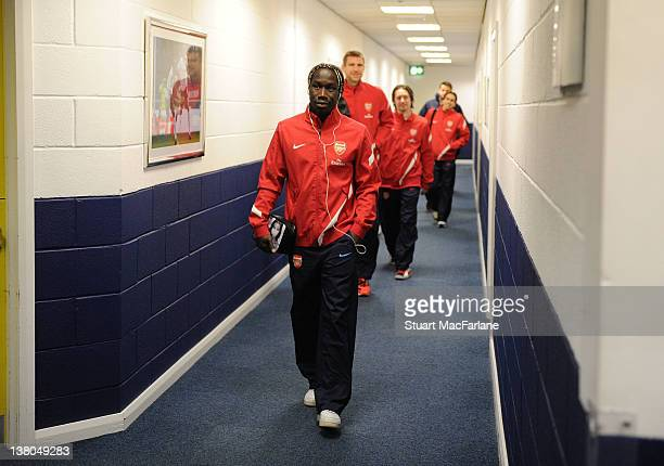 Arsenal defender Bacary Sagna arrives at the away changing room before the Barclays Premier League match between Bolton Wanderers and Arsenal at the...