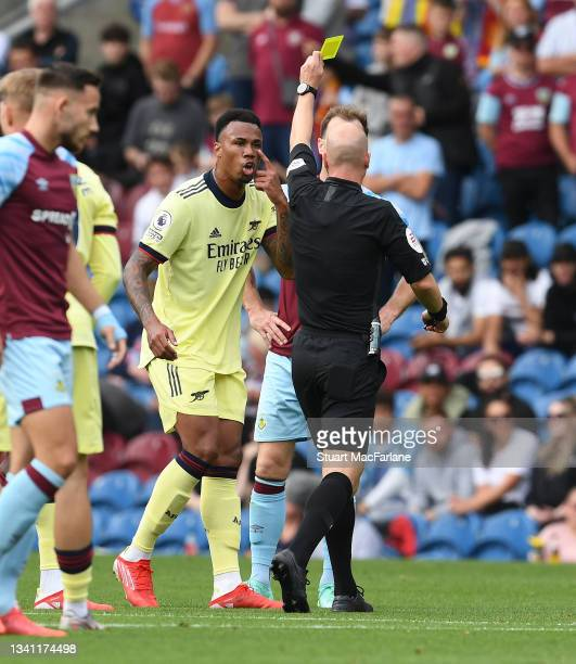 Arsenal defender Gabriel looks on as referee Anthony Taylor shows the yellow card to Burnley's Ashley Barnes during the Premier League match between...