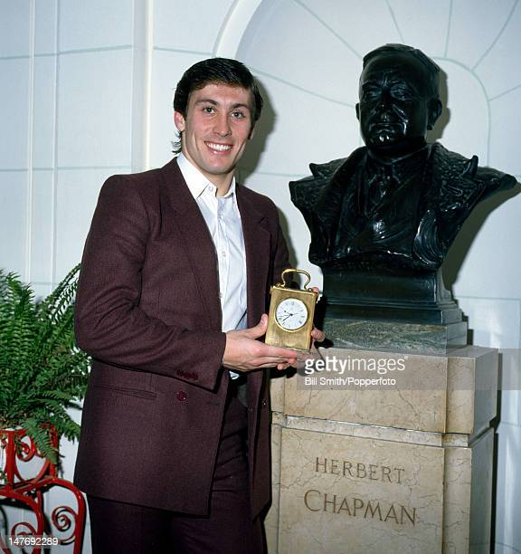 Arsenal defender Kenny Sansom with his award for being voted player of the year by the Arsenal supporters pictured beside the bust of the legendary...