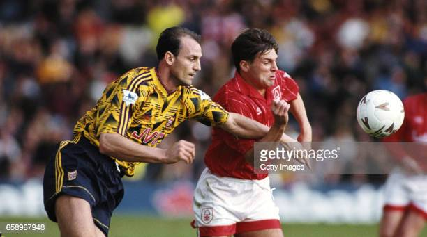 Arsenal defender Steve Bould challenges Gary Bannister of Notts Forest during an FA Premier League match at City Ground on October 17 1992 in...