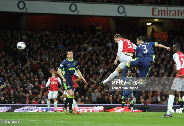 Arsenal defender Thomas Vermaelen outjumps Wigan defender Antolin Alcaraz to score for Arsenal during the Barclays Premier League match between...