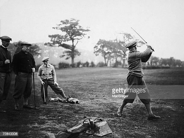 Arsenal defender Tom Parker takes a swing during a team training day at a golf course in Hatch End 14th November 1929 Team mate David Jack manager...