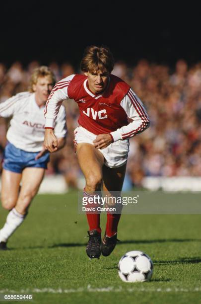 Arsenal defender Tony Adams in action watched by West Ham striker Frank McAvennie during a First Divsion match at Highbury on November 8 1986 in...