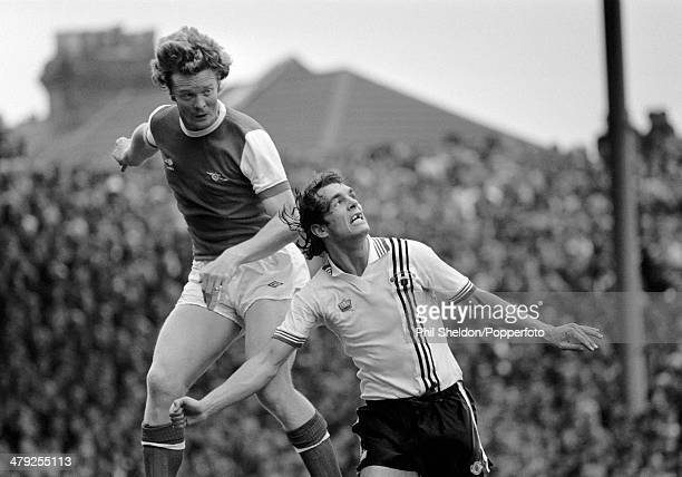 Arsenal defender Willie Young leaps high above Manchester United striker Joe Jordan during their First Division match at Highbury in London 25th...