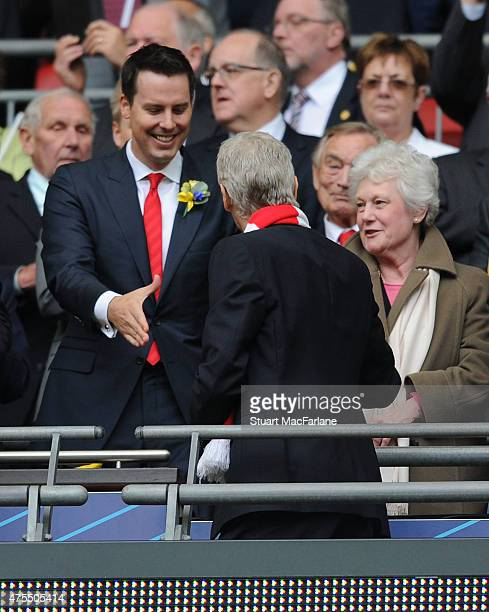 Arsenal director Josh Kroenke shakes hands with manager Arsene Wenger after the FA Cup Final between Aston Villa and Arsenal at Wembley Stadium on...