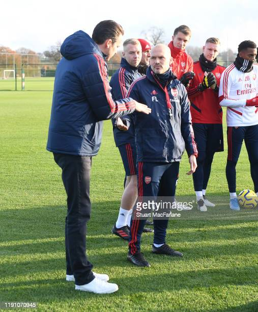 Arsenal Director Josh Kroenke speaks with Interim Head Coach Freddie Ljungberg after talking to the players and staff before a training session at...