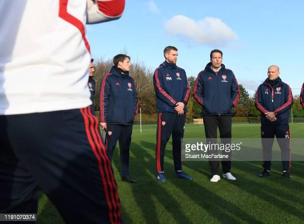 Arsenal Director Josh Kroenke talks to Academy Director Per Mertesacker interim Head Coach Freddie Ljungberg players and staff beforea training...