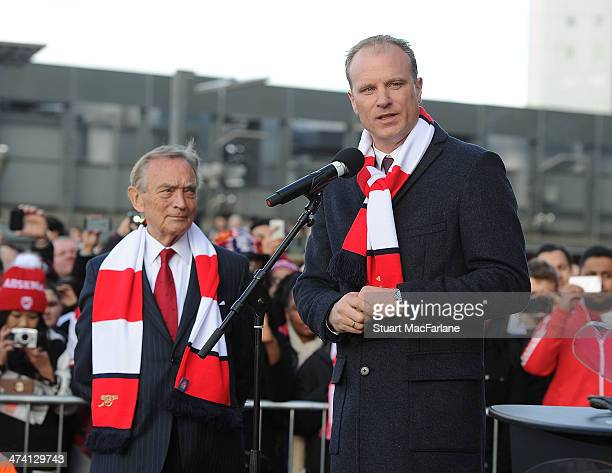 Arsenal director Ken Friar with Dennis Bergkamp at the unveiling of a statue in his honour before the Barclays Premier League match between Arsenal...
