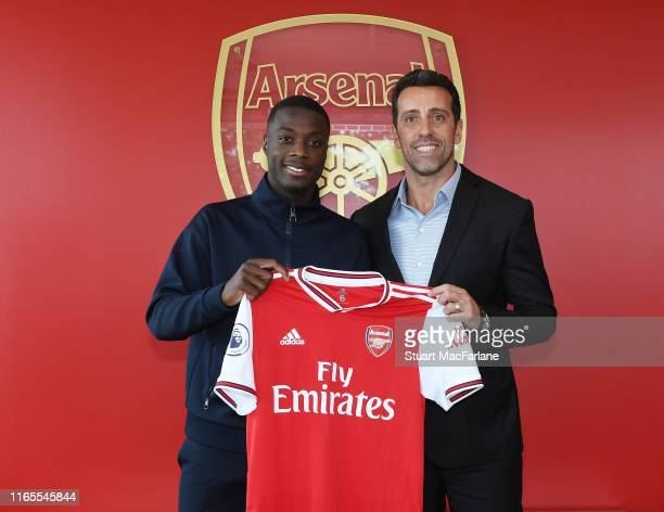 Arsenal Director of Football Edu poses with new signing Nicolas Pepe at London Colney on July 31 2019 in St Albans England