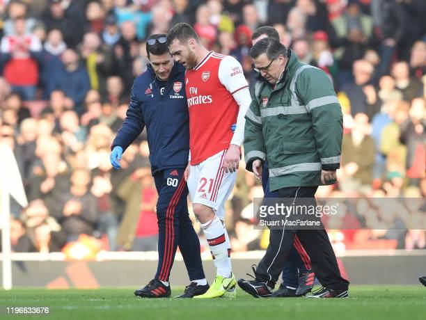 Arsenal doctor Gary O'Driscoll with injured Calum Chambers during the Premier League match between Arsenal FC and Chelsea FC at Emirates Stadium on...