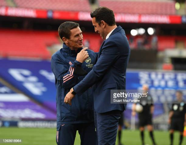 Arsenal Doctor Gary O'Driscoll with Technical Director Edu after the FA Cup Final match between Arsenal and Chelsea at Wembley Stadium on August 01...