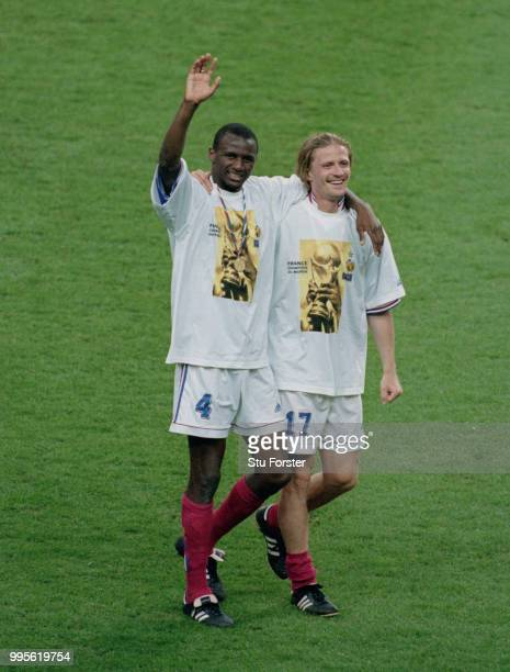 Arsenal duo Patrick Viera and Emmanuel Petit celebrate after France win the 1998 FIFA World Cup Final against Brazil at Stade de France on July 12,...