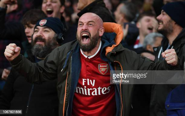 Arsenal fan celebrates the 3rd goal during the Premier League match between Arsenal FC and Tottenham Hotspur at Emirates Stadium on December 2 2018...