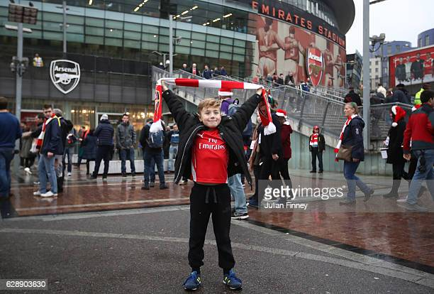 Arsenal fan poses for a photo outside the stadium before the Premier League match between Arsenal and Stoke City at the Emirates Stadium on December...