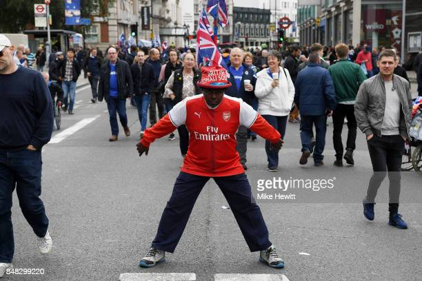 Arsenal fan poses for a photo prior to the Premier League match between Chelsea and Arsenal at Stamford Bridge on September 17 2017 in London England