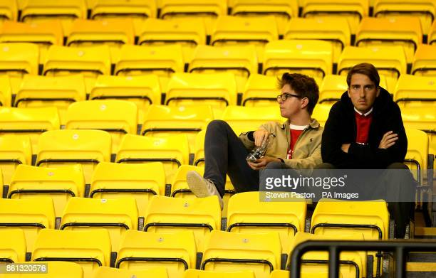 Arsenal fans appear dejected after the final whistle during the Premier League match at Vicarage Road Watford