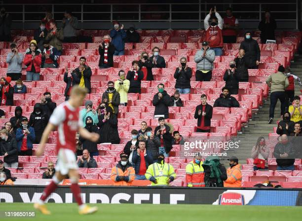 Arsenal fans applaud Martin Odegaard after his substitution during the Premier League match between Arsenal and Brighton & Hove Albion at Emirates...