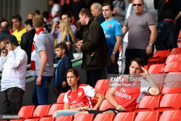 Arsenal fans are dejected after the Premier League match between Liverpool and Arsenal at Anfield on August 27 2017 in Liverpool England