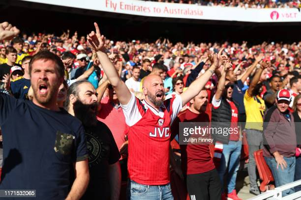 Arsenal fans are seen cheering ahead of the Premier League match between Arsenal FC and Tottenham Hotspur at Emirates Stadium on September 01 2019 in...