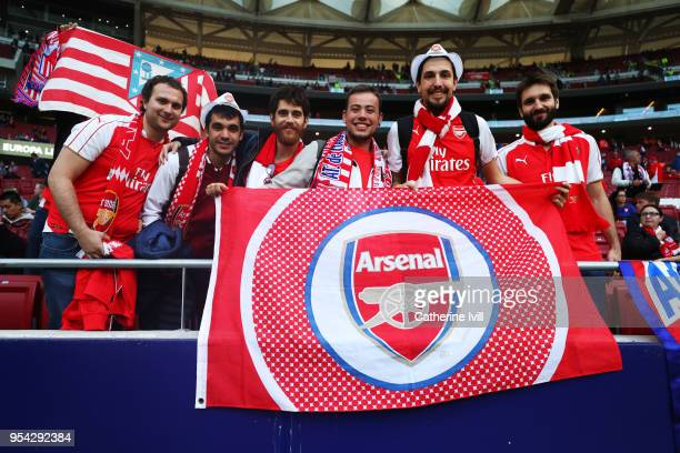 Arsenal fans arrive for the UEFA Europa League Semi Final second leg match between Atletico Madrid and Arsenal FC at Estadio Wanda Metropolitano on...