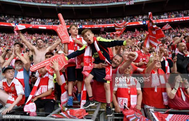 Arsenal fans celebrate after The Emirates FA Cup Final between Arsenal and Chelsea at Wembley Stadium on May 27 2017 in London England