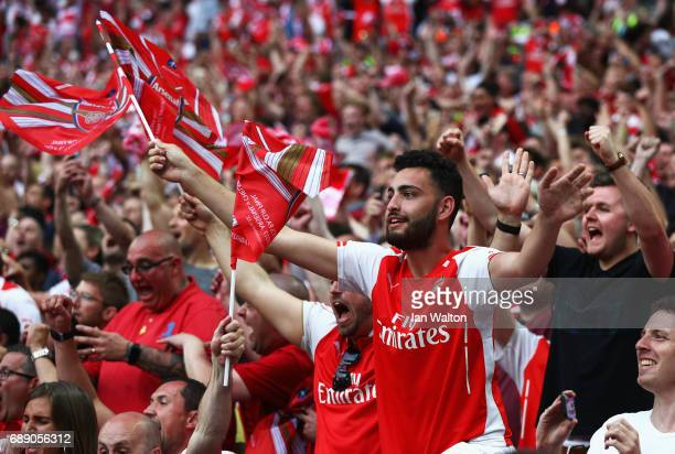 Arsenal fans celebrate afterThe Emirates FA Cup Final between Arsenal and Chelsea at Wembley Stadium on May 27 2017 in London England