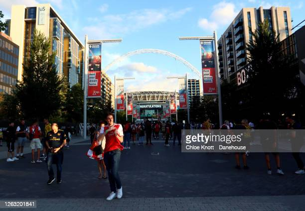 Arsenal fans celebrate at full time outside Wembley Stadium during the FA Cup Final match between Arsenal and Chelsea at Wembley Stadium on August...