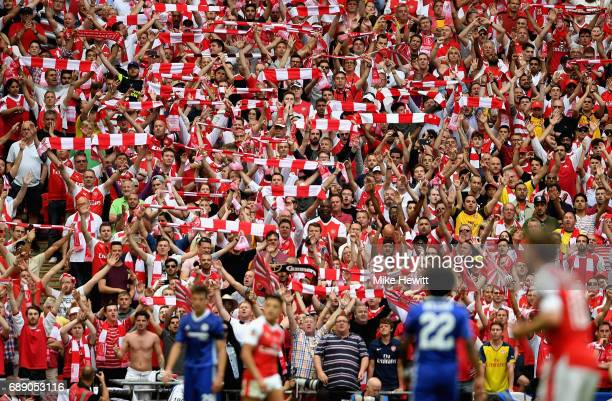 Arsenal fans celebrate during The Emirates FA Cup Final between Arsenal and Chelsea at Wembley Stadium on May 27 2017 in London England